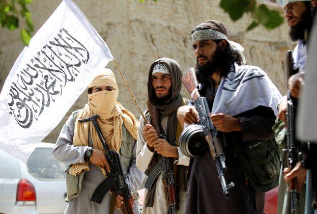 FILE PHOTO: Taliban walk as they celebrate ceasefire in Ghanikhel district of Nangarhar province, Afghanistan June 16, 2018.REUTERS/Parwiz