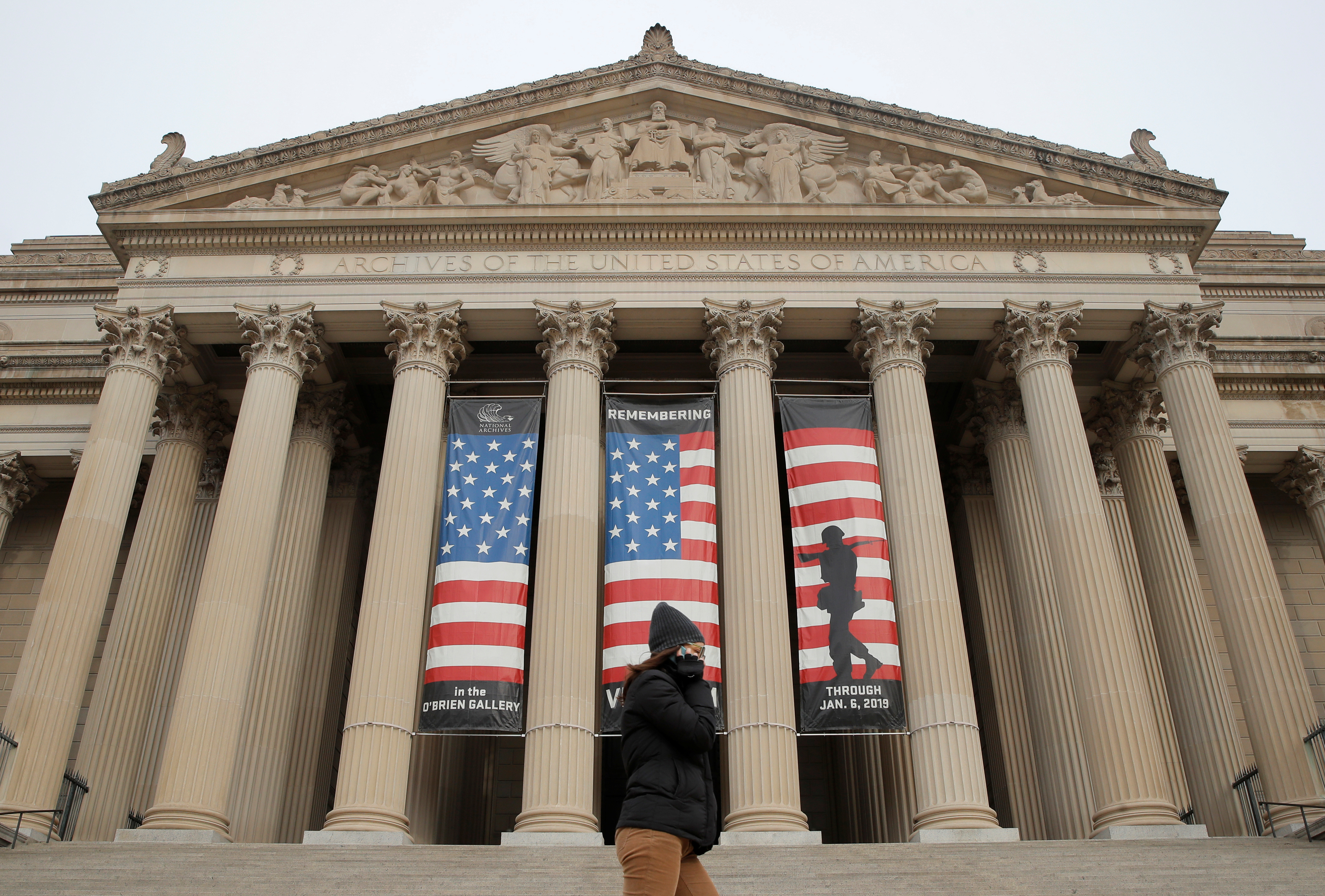 A woman walks past the entrance to the National Archives which is closed due to a partial government shutdown continues, in Washington, U.S., January 7, 2019. REUTERS/Jim Young