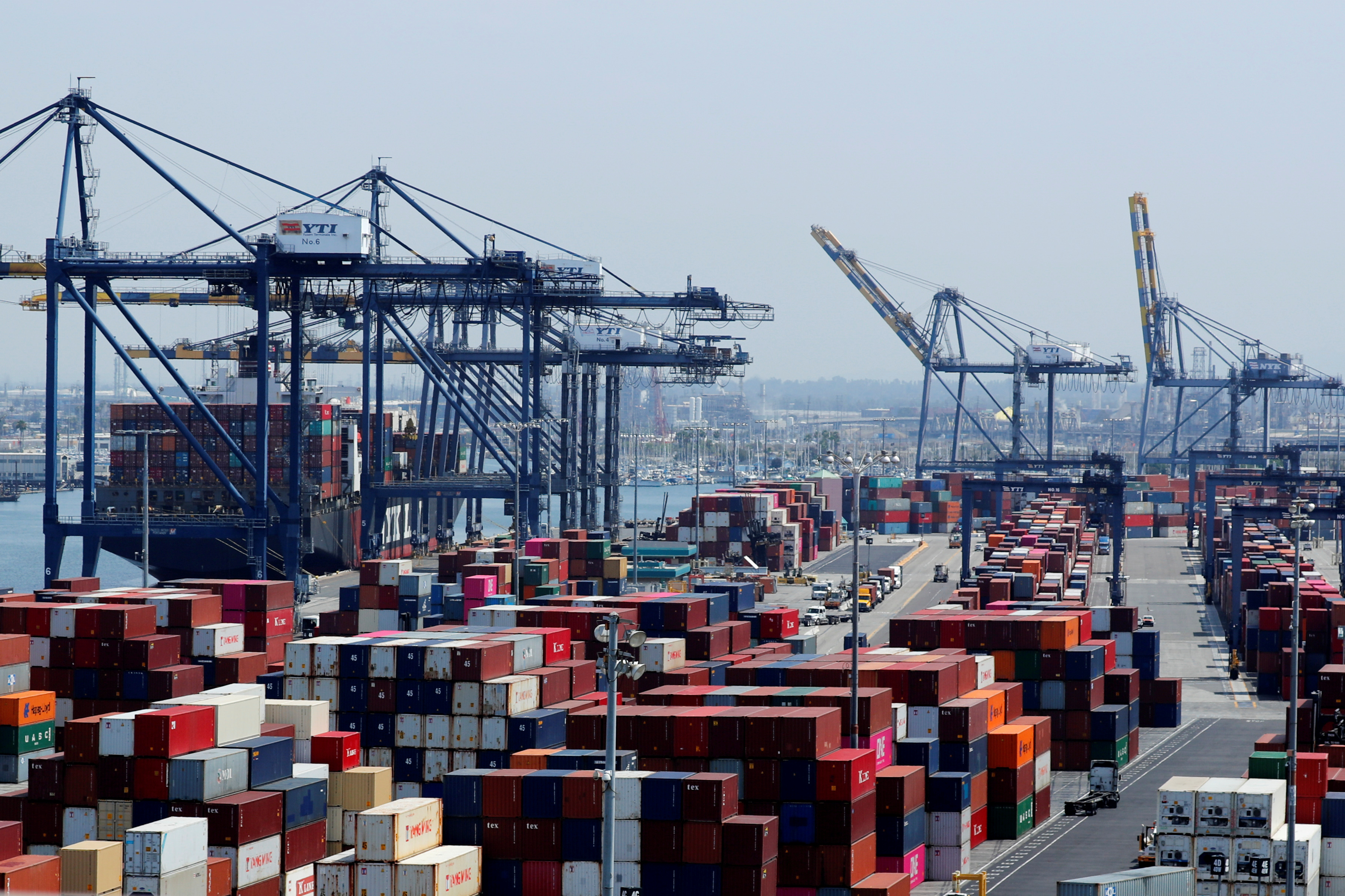 FILE PHOTO: Ship and containers are shown at the port of Los Angeles in Los Angeles, California, U.S. July 16, 2018. REUTERS/Mike Blake/File Photo