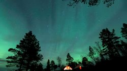 FILE PHOTO: The Aurora Borealis (Northern Lights) is seen over a mountain camp north of the Arctic Circle, near the village of Mestervik, Norway September 30, 2014.REUTERS/Yannis Behrakis