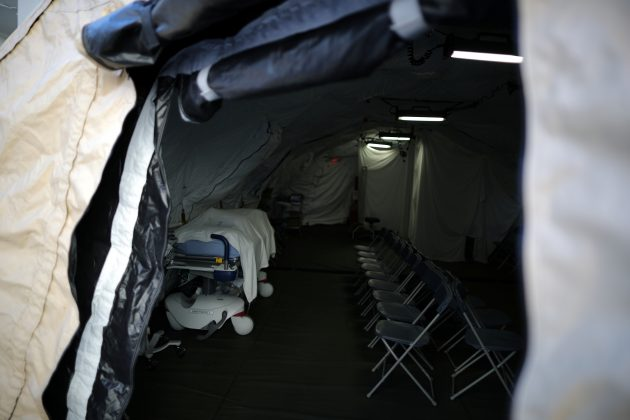 FILE PHOTO: A triage surge tent is seen outside Loma Linda University Health Center for patients infected with an influenza A strain known as H3N2, in Loma Linda, California U.S. January 17, 2018. REUTERS/Lucy Nicholson