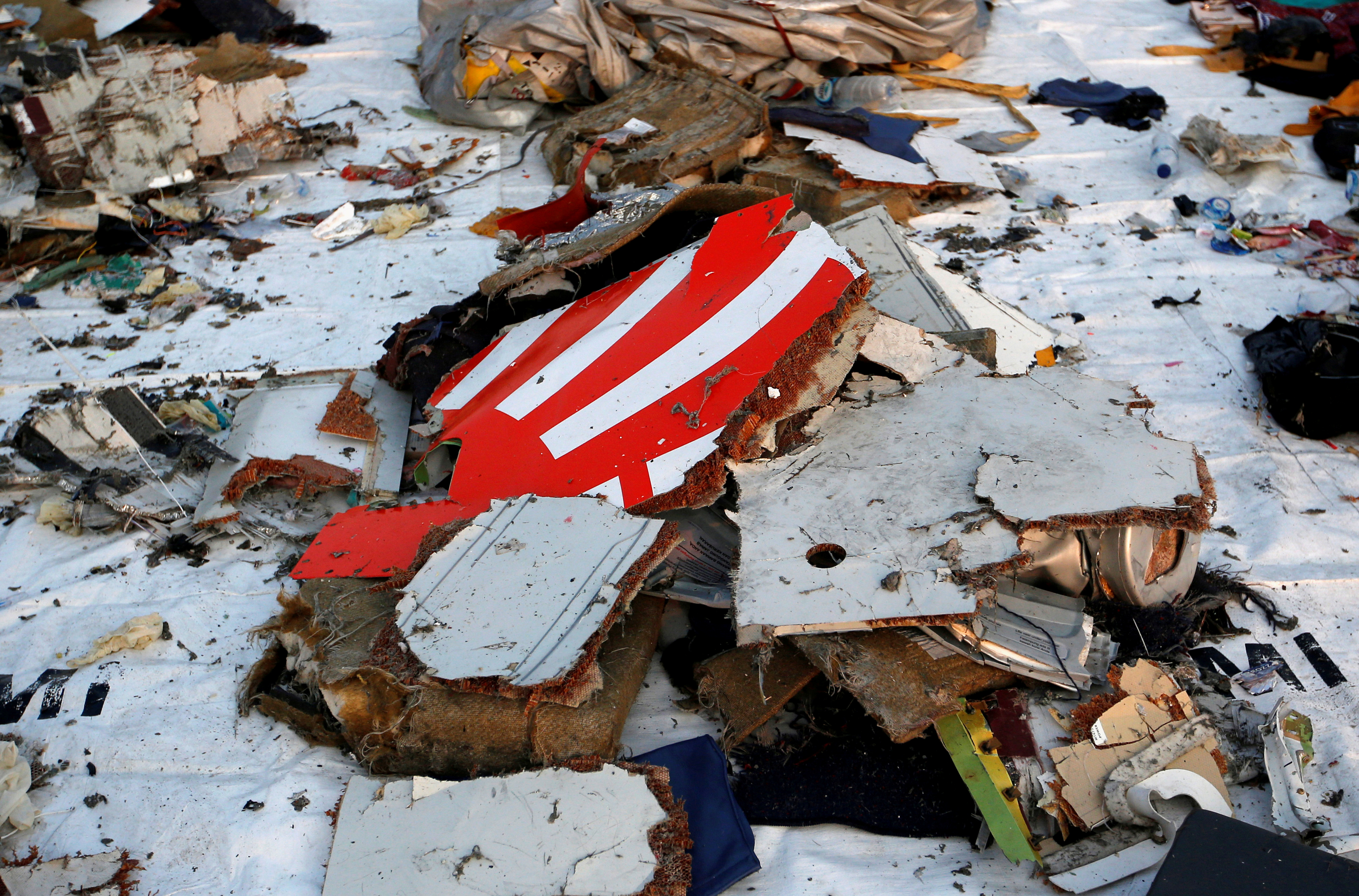 FILE PHOTO - Wreckage recovered from Lion Air flight JT610, that crashed into the sea, lies at Tanjung Priok port in Jakarta, Indonesia, October 29, 2018. REUTERS/Willy Kurniawan/File Photo