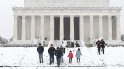 Visitors make their way through snow left by Winter Storm Gia, which paralyzed much of the nation's midsection, at the Lincoln Memorial in Washington, D.C., U.S., January 13, 2019. REUTERS/Mike Theiler