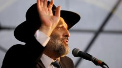 FILE PHOTO: Israeli Interior Minister Aryeh Deri speaks during an annual pilgrimage to the gravesite of Moroccan-born sage and Jewish mystic Rabbi Yisrael Abuhatzeira, also known as the Baba Sali, on the anniversary of his death in the southern town of Netivot, Israel January 9, 2019 REUTERS/Amir Cohen/File Photo