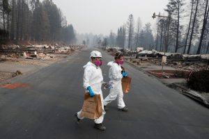 FILE PHOTO: Forensic anthropologists recover remains from a trailer home destroyed by the Camp Fire in Paradise, California, U.S., November 17, 2018. REUTERS/Terray Sylvester/File Photo