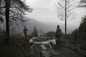 FILE PHOTO: Statues are seen on a property damaged by the Camp Fire in Paradise, California, U.S. November 21, 2018. REUTERS/Elijah Nouvelage/File Photo