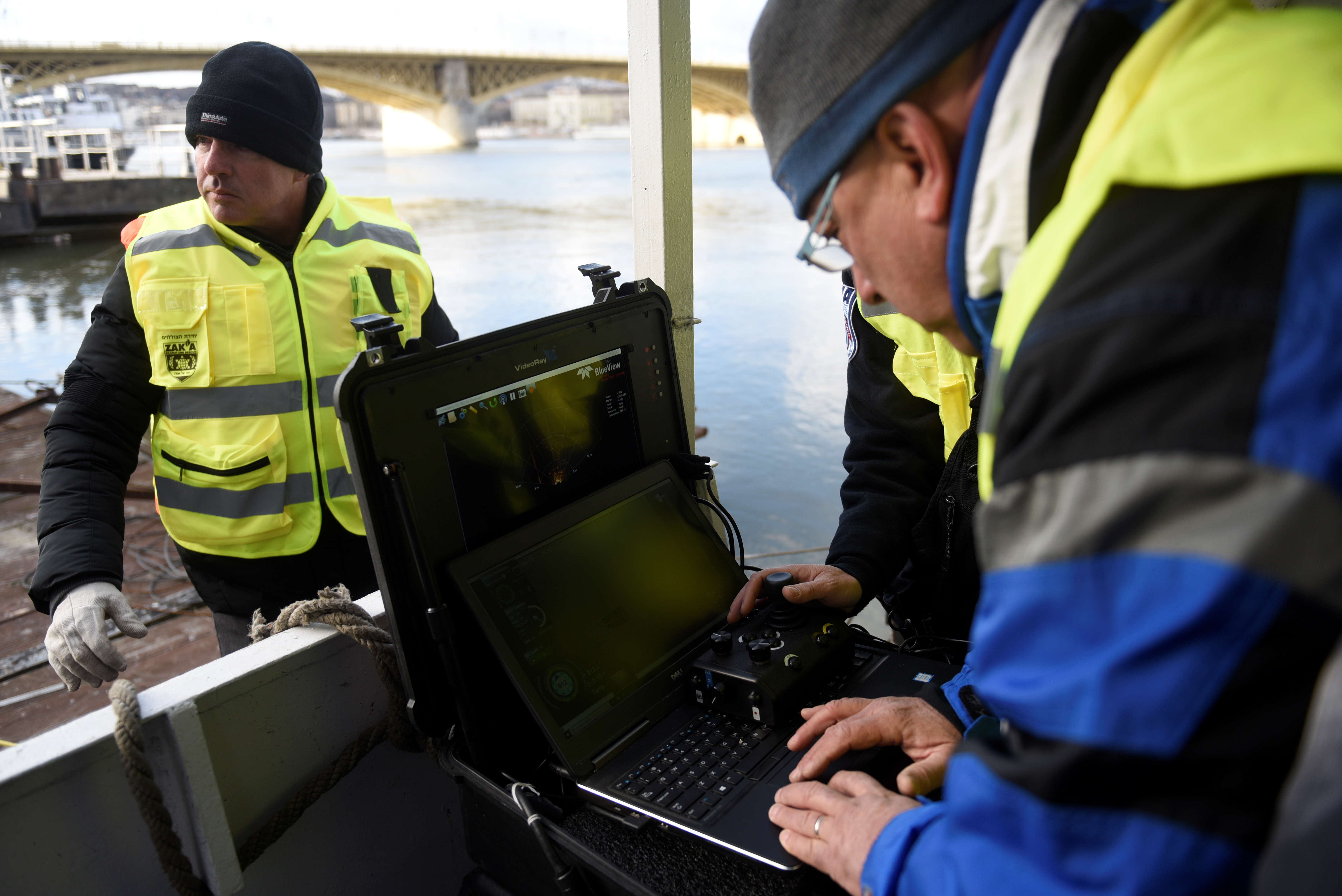 Volunteers of Israeli rescue and recovery organisation ZAKA survey images transmitted by an underwater sonar during a search for the remains of Holocaust victims murdered on the banks of the Danube river in 1944 in Budapest, Hungary January 15, 2019. REUTERS/Tamas Kaszas