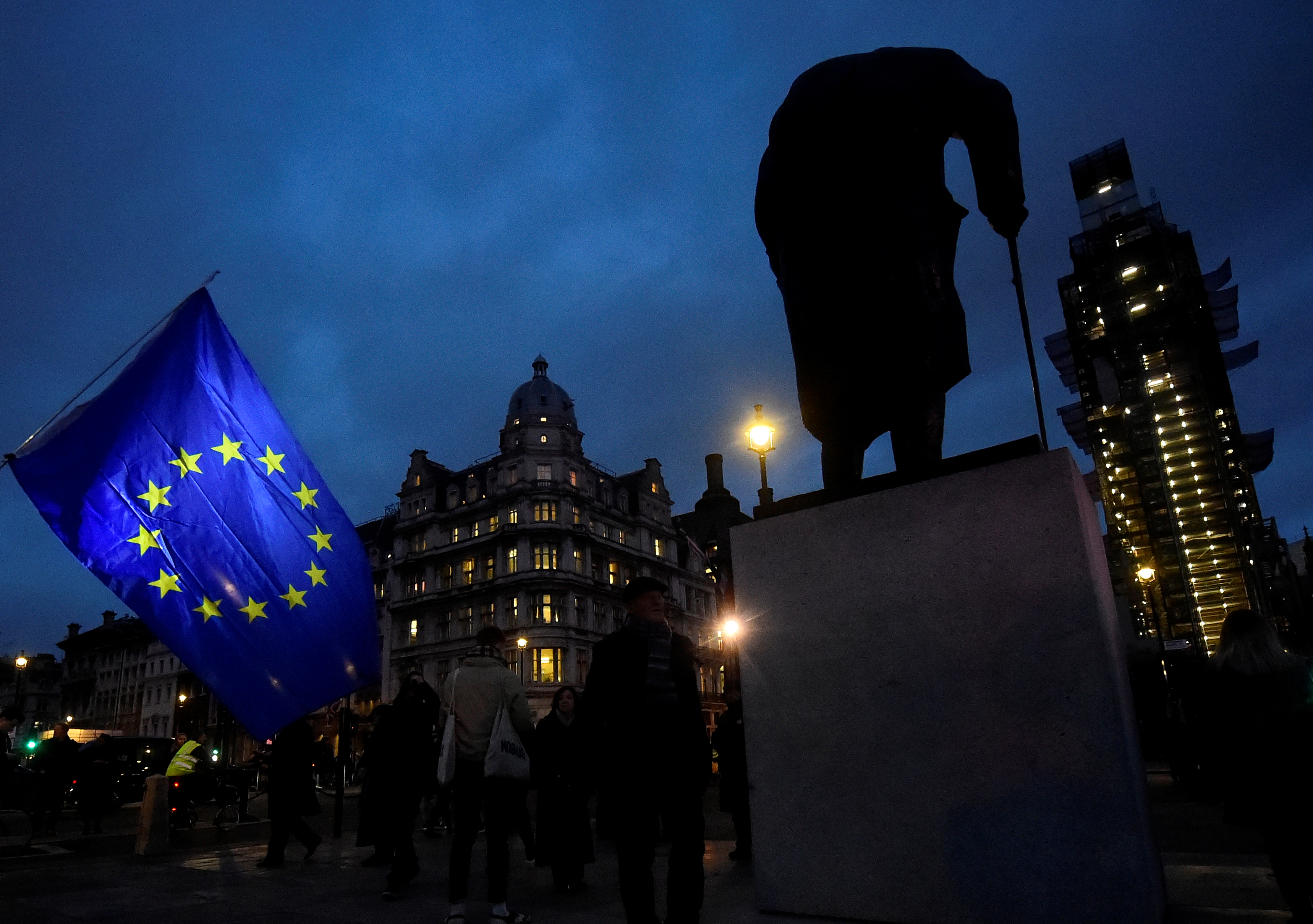 FILE PHOTO: An EU flag flutters next to the statue of Winston Churchill outside the Houses of Parliament, ahead of a vote on Prime Minister Theresa May's Brexit deal, in London, Britain January 15, 2019. REUTERS/Clodagh Kilcoyne