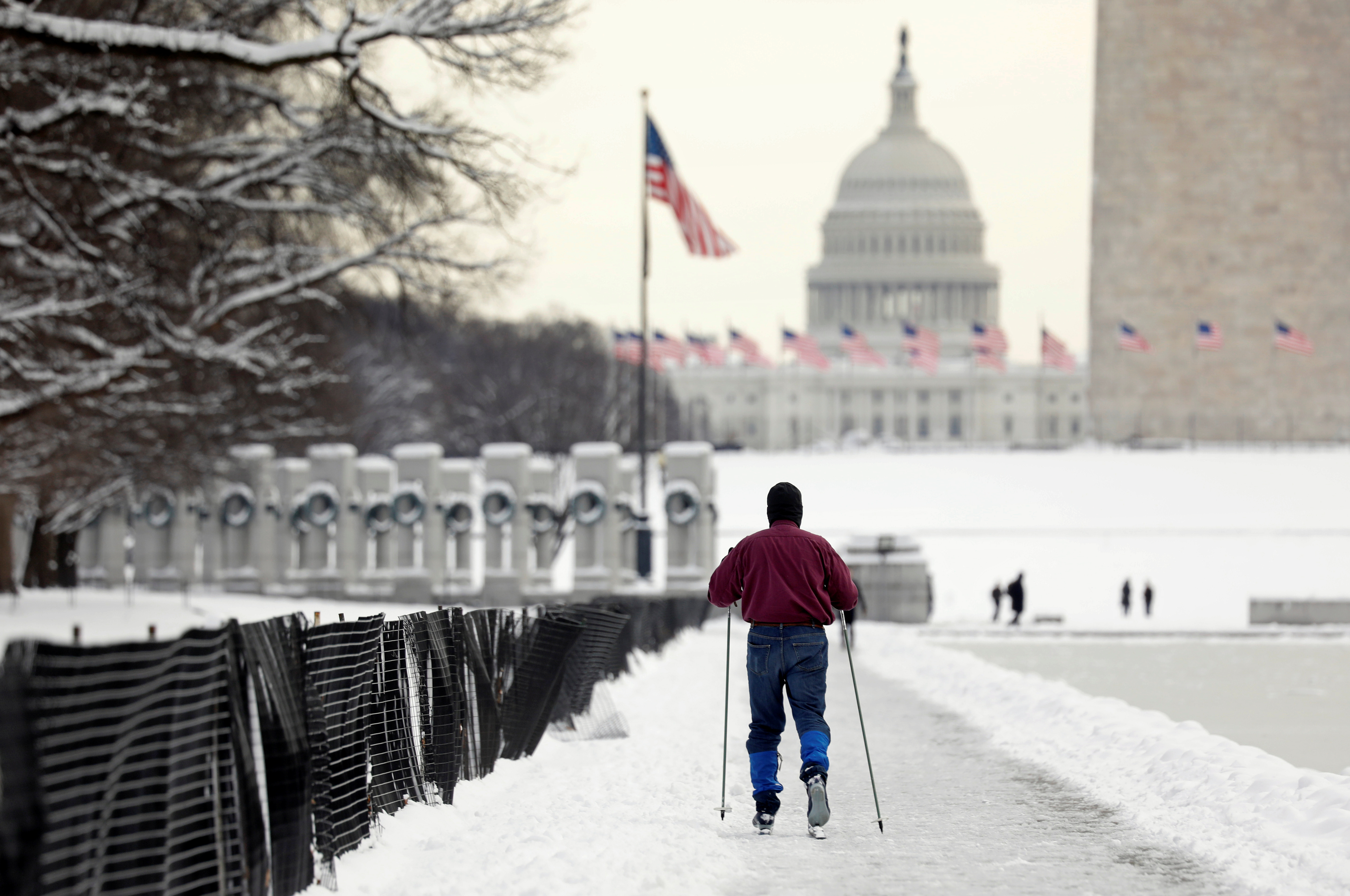 FILE PHOTO: A skier makes his way toward the U.S. Capitol, on Day 24 of the government shutdown in Washington D.C., U.S., January 14, 2019. REUTERS/Kevin Lamarque