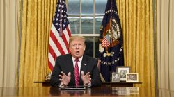 FILE PHOTO: U.S. President Donald Trump deliversa televised address to the nation from his desk in the Oval Office about immigration and the southern U.S. border on the 18th day of a partial government shutdown at the White House in Washington, U.S., January 8, 2019. REUTERS/Carlos Barria