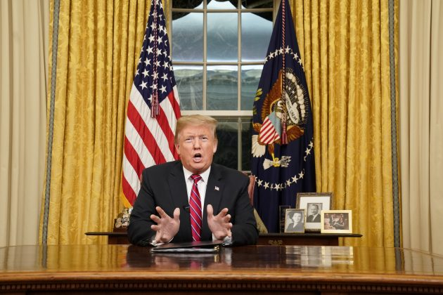 FILE PHOTO: U.S. President Donald Trump delivers a televised address to the nation from his desk in the Oval Office about immigration and the southern U.S. border on the 18th day of a partial government shutdown at the White House in Washington, U.S., January 8, 2019. REUTERS/Carlos Barria