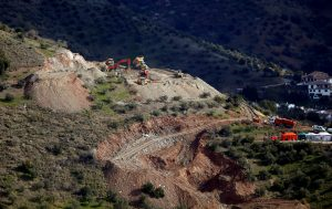 Diggers and trucks remove sand at the area where Julen, a Spanish two-year-old boy fell into a deep well four days ago when the family was taking a stroll through a private estate, in Totalan, southern Spain, January 17, 2019. REUTERS/Jon Nazca