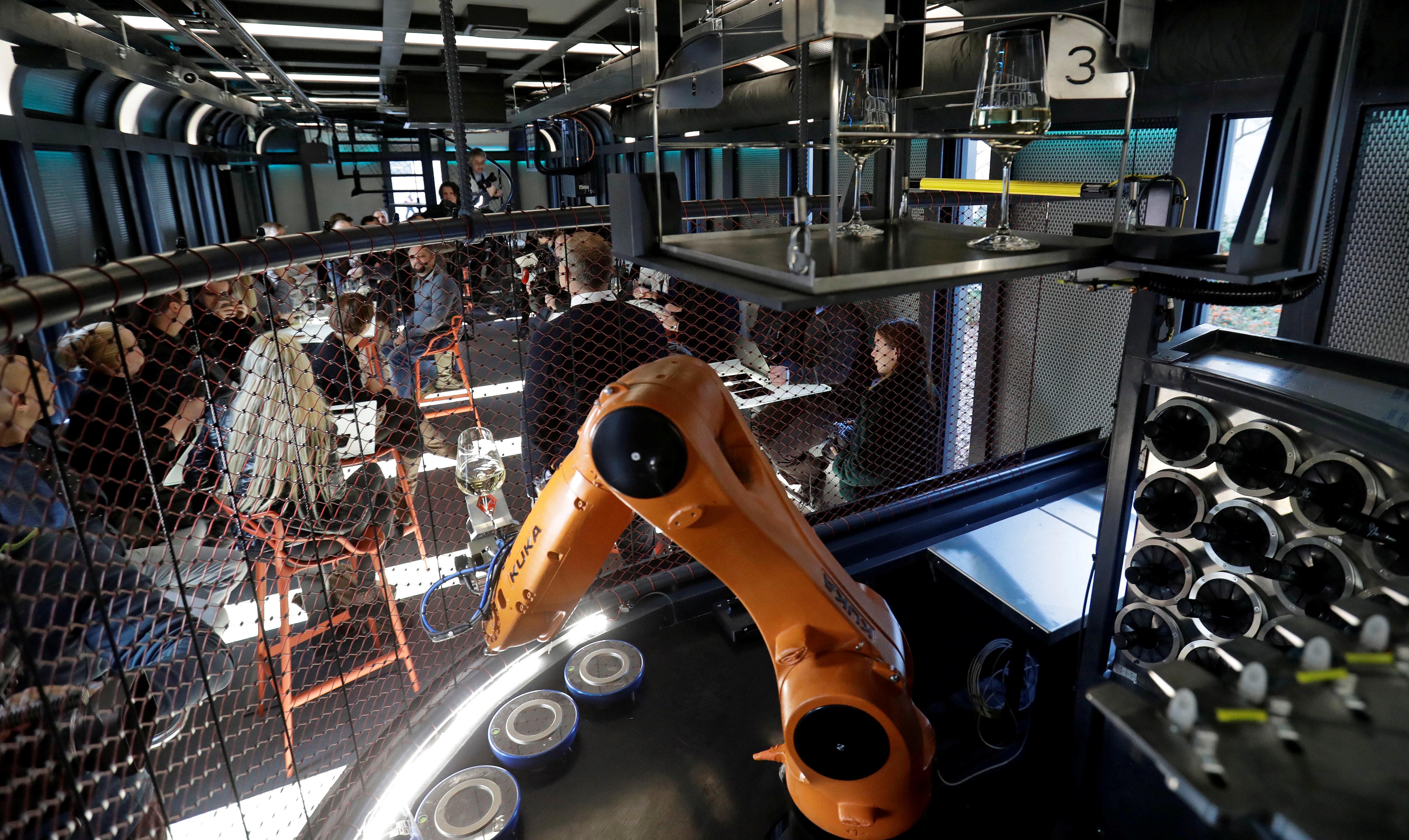 FILE PHOTO: A robotic bartender prepares drinks inside a space modul-like structure in Prague, Czech Republic, November 28, 2018. REUTERS/David W Cerny/File Photo
