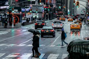 Pedestrians walk in the rainy day at Time Square in the Manhattan borough of New York City, New York, U.S., January 20, 2019.REUTERS/Jeenah Moon