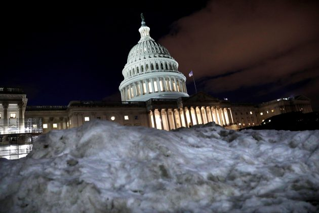 FILE PHOTO: The U.S. Capitol is seen behind a snow pile in Washington, U.S., January 16, 2019. REUTERS/Yuri Gripas/File Photo
