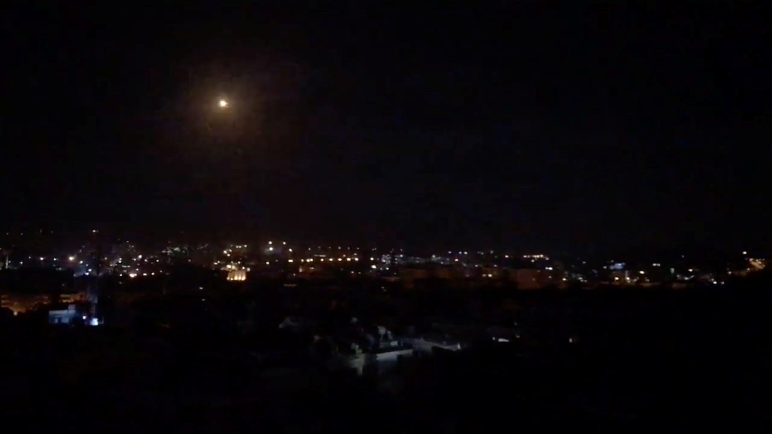What is believed to be guided missiles are seen in the sky during what is reported to be an attack in Damascus, Syria, January 21, 2019, in this still image taken from a video obtained from social media. Facebook Diary of a Mortar Shell in Damascus/Youmiyat Qadifat Hawun fi Damashq/via REUTERS