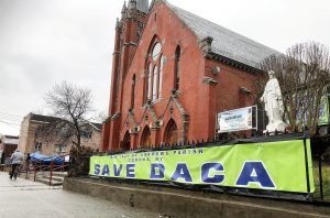 "Banners outside a Catholic church in New York's Queens borough express support for ""Dreamer"" immigrants in New York, U.S. January 20, 2019. REUTERS/Nick Zieminski"