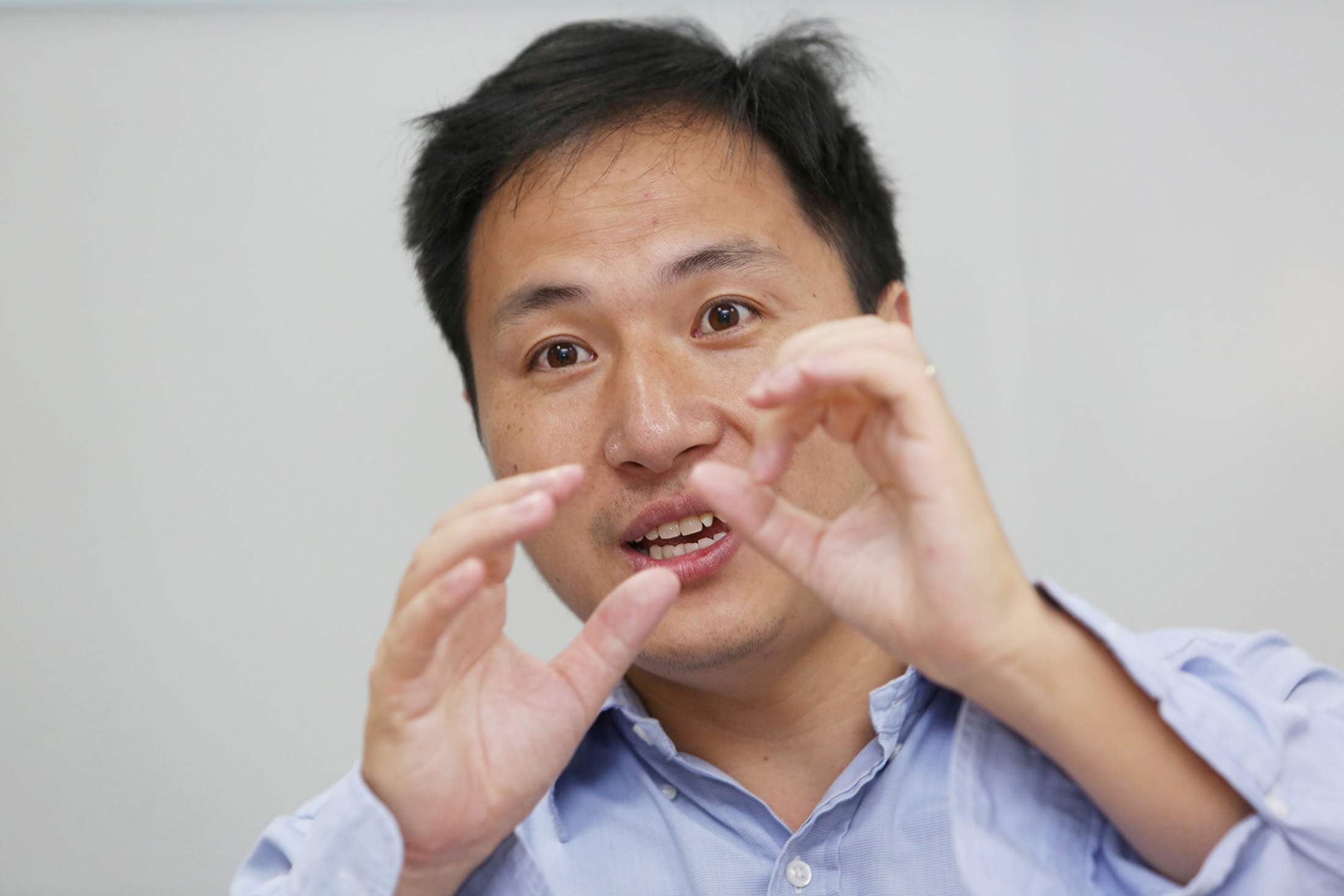 FILE PHOTO: Scientist He Jiankui speaks at his company Direct Genomics in Shenzhen, Guangdong province, China July 18, 2017. Picture taken July 18, 2017. REUTERS/Stringer