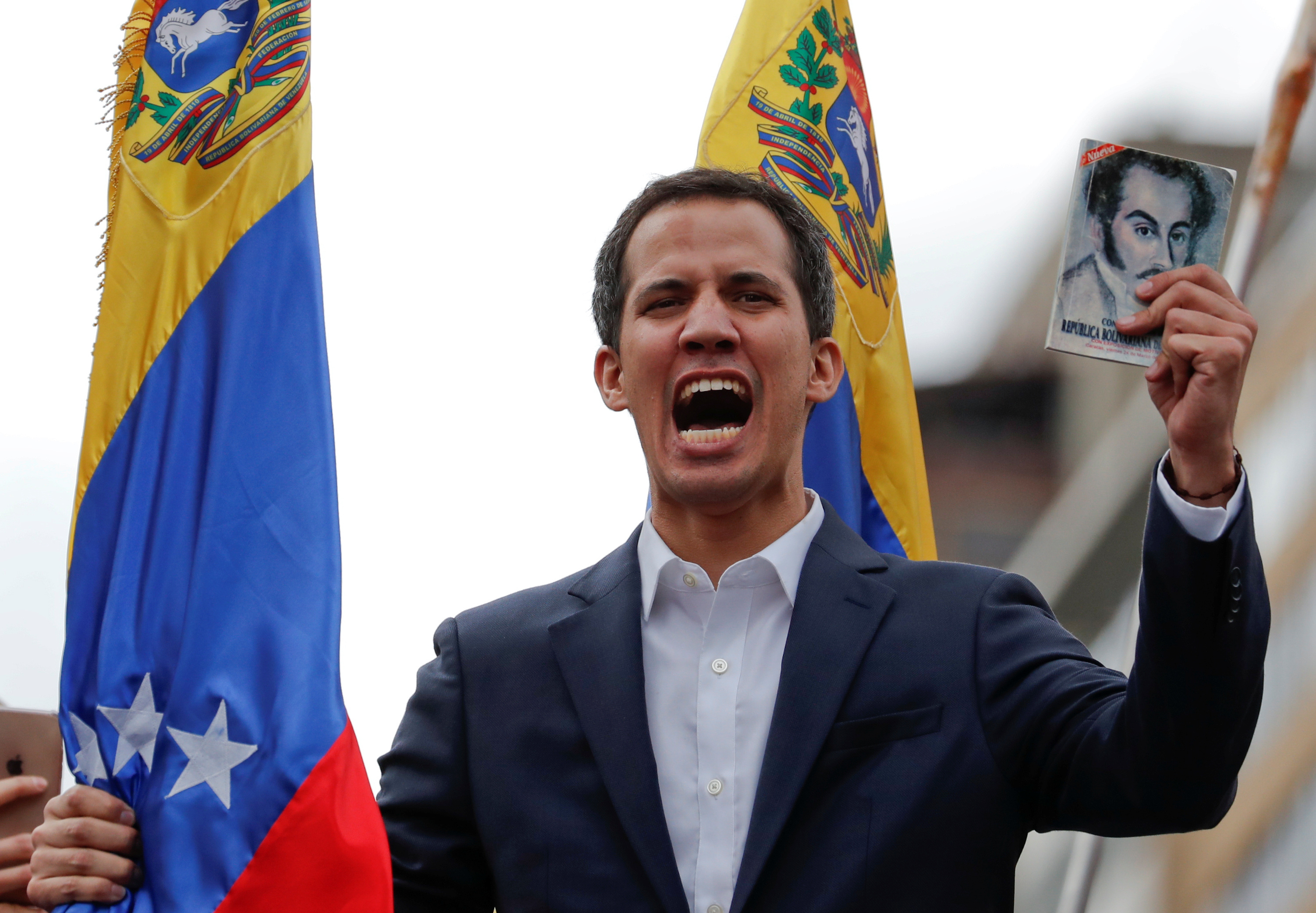 Juan Guaido, President of Venezuela's National Assembly, holds a copy of Venezuelan constitution during a rally against Venezuelan President Nicolas Maduro's government and to commemorate the 61st anniversary of the end of the dictatorship of Marcos Perez Jimenez in Caracas, Venezuela January 23, 2019. REUTERS/Carlos Garcia Rawlins