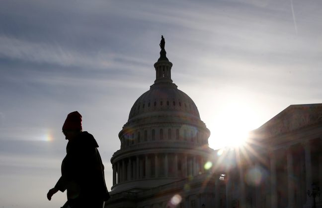 A visitor walks by the U.S. Capitol on day 32 of a partial government shutdown as it becomes the longest in U.S. history in Washington, U.S., January 22, 2019. REUTERS/Jim Young