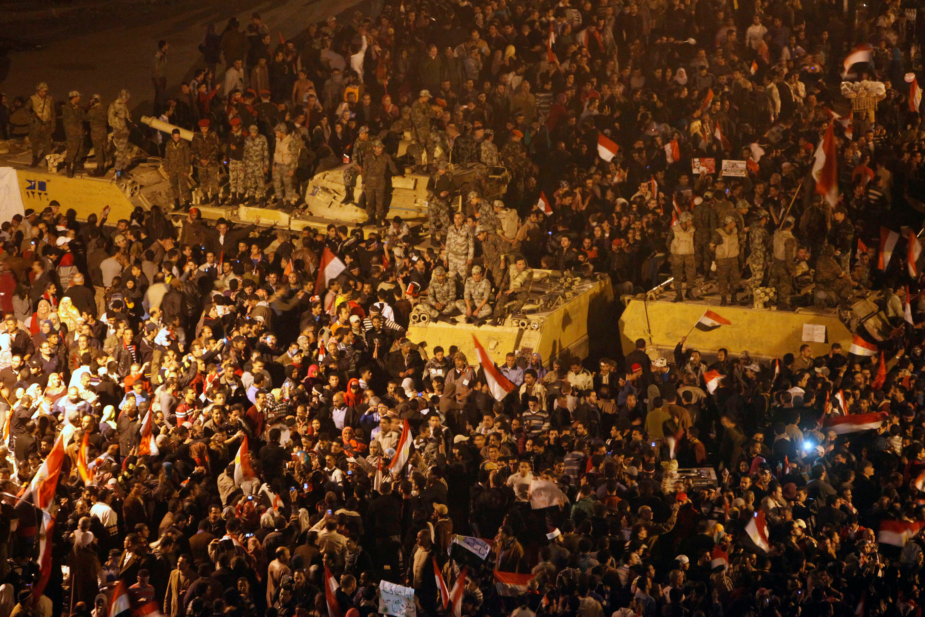 FILE PHOTO: Anti-government protesters celebrate next to soldiers inside Tahrir Square after the announcement of Egyptian President Hosni Mubarak's resignation in Cairo February 11, 2011. REUTERS/Asmaa Waguih/File Photo