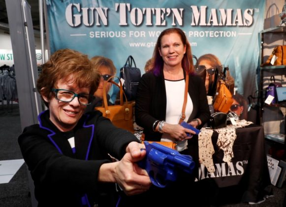 Claudia Chisholm, CEO of Gun Tote'n Mamas, and Carrie Lightfoot, founder of The Well Armed Woman, pose in the Gun Tote'n Mamas booth during the SHOT (Shooting, Hunting, Outdoor Trade) Show in Las Vegas, Nevada, U.S., January 22, 2019. REUTERS/Steve Marcus
