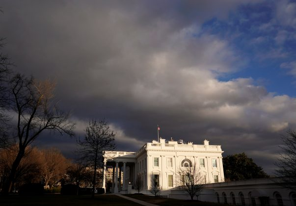 At the end of a stormy day, the setting sun breaks through the clouds to illuminate the White House in Washington, U.S., January 24, 2019. REUTERS/Kevin Lamarque