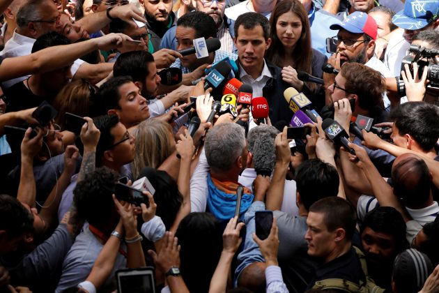 FILE PHOTO: Venezuelan opposition leader and self-proclaimed interim president Juan Guaido accompanied by his wife Fabiana Rosales, speaks to the media after a holy Mass at a local church in Caracas, Venezuela, Jan. 27, 2019. REUTERS/Carlos Barria/File Photo