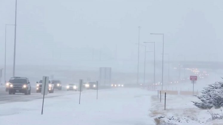 FILE PHOTO: Cars move along a snow-covered road in Denver, U.S., January 22, 2019 in this video grab obtained from social media video by Reuters January 28, 2019. Denver International Airport/via REUTERS