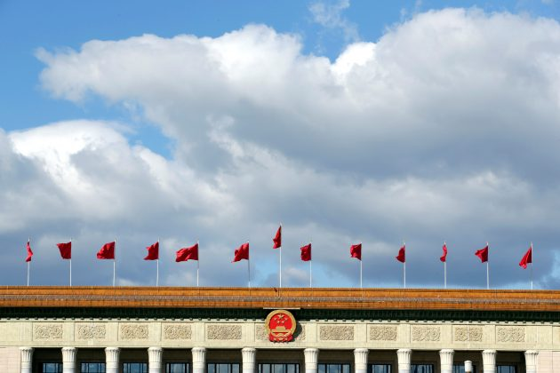 Red flags flutter on the top of the Great Hall of the People in Beijing, China September 30, 2018. Picture taken September 30, 2018. REUTERS/Jason Lee