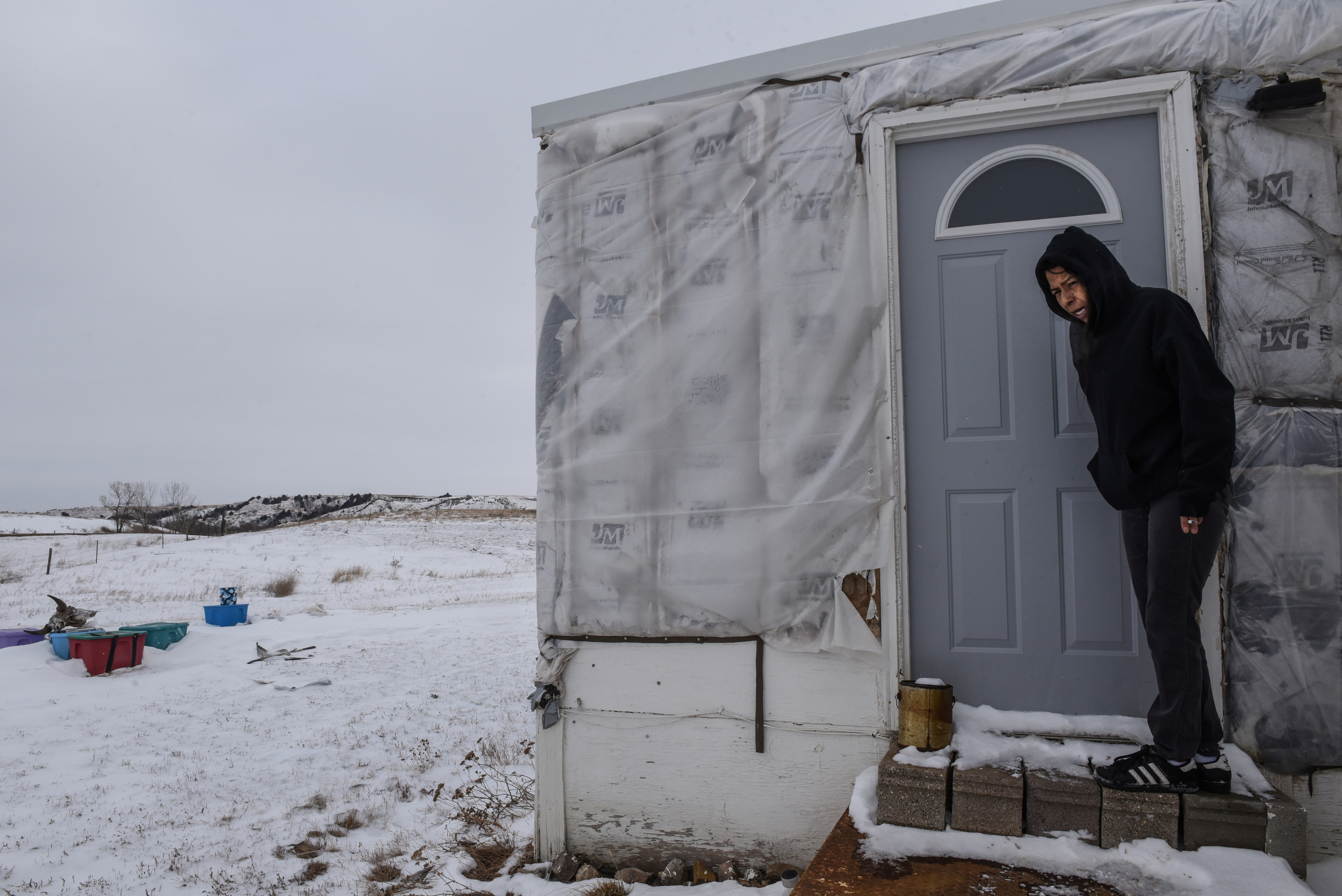 Lynn Provost stands in front of her trailer on the Cheyenne River Indian Reservation in Eagle Butte, South Dakota, U.S. January 25, 2019. REUTERS/Stephanie Keith