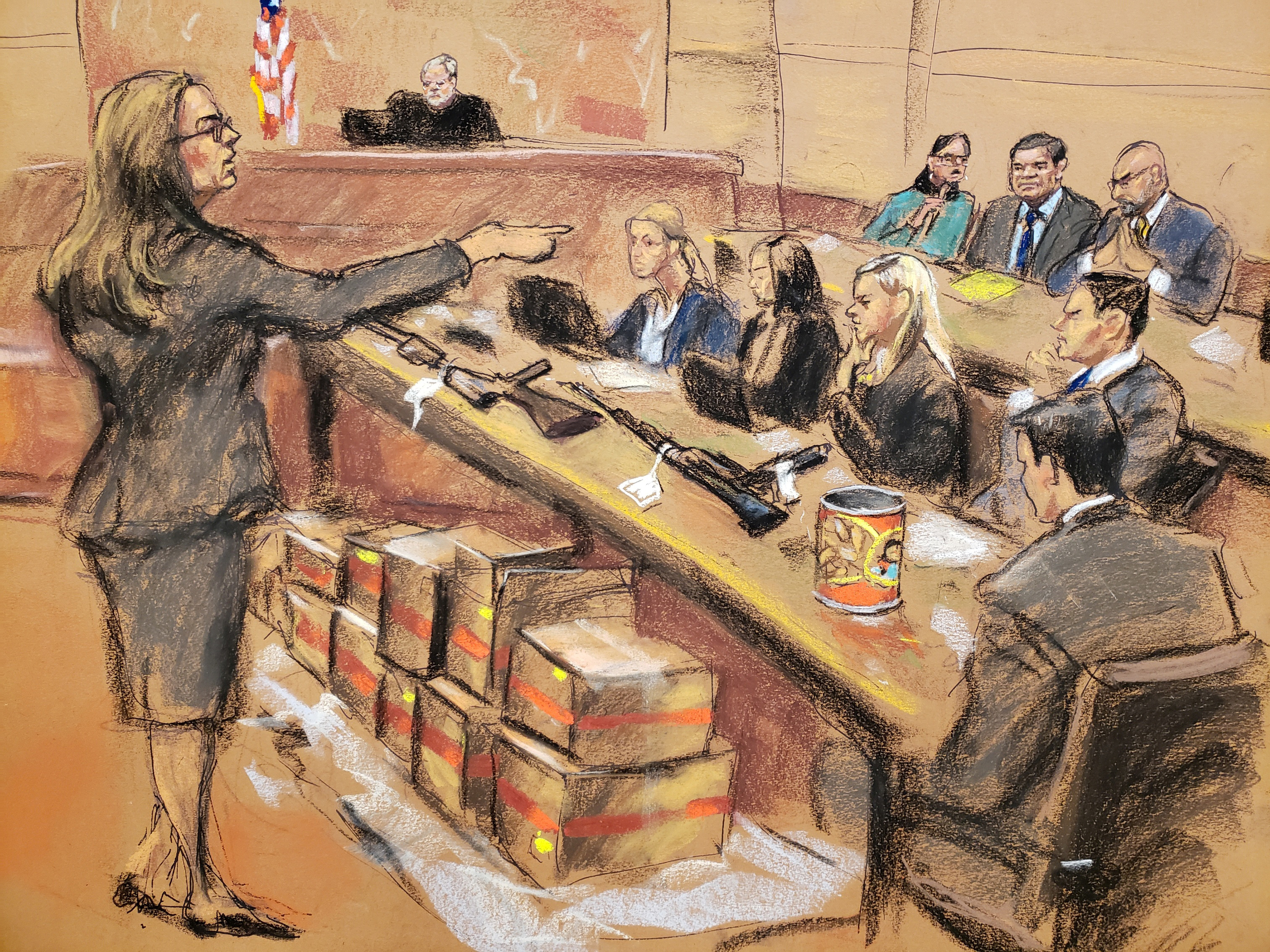 "Assistant U.S. Attorney Andrea Goldbarg points at Mexican drug lord Joaquin ""El Chapo"" Guzman (back row C) in this courtroom sketch during Guzman's trial in Brooklyn federal court in New York City, U.S., January 30, 2019. REUTERS/Jane Rosenberg"