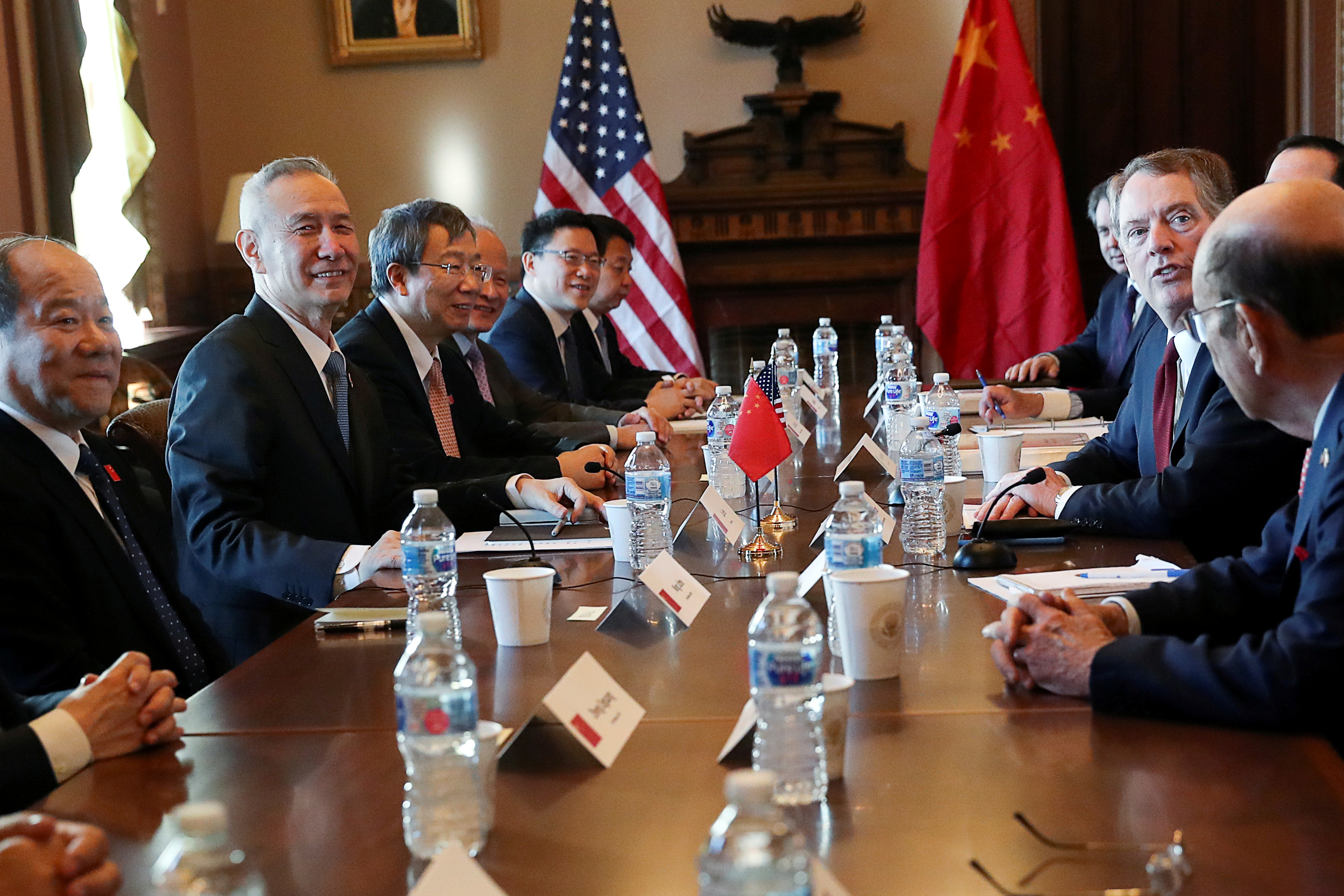 FILE PHOTO: U.S. Trade Representative Robert Lighthizer (2nd right) sits across from China's Vice Premier Liu He (left) during the opening of US-China Trade Talks in the Eisenhower Executive Office Building at the White House in Washington, U.S., January 30, 2019. REUTERS/Leah Millis/File Photo