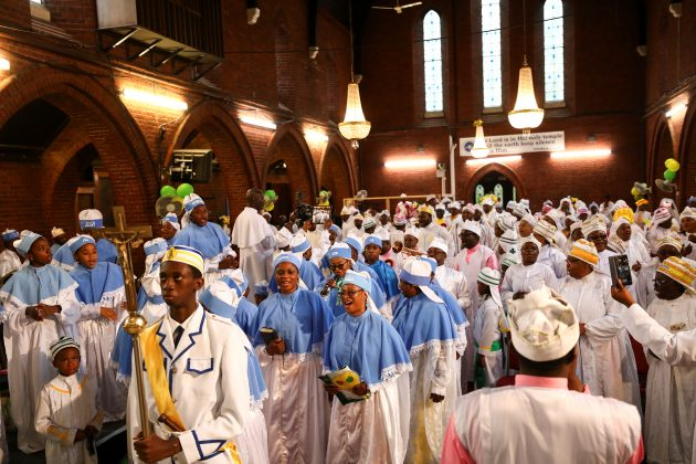 Members of the Eternal Sacred Order of Cherubim & Seraphim Church sing as they celebrate their annual Thanksgiving in Elephant and Castle, London, Britain, July 29, 2018. REUTERS/Simon Dawson