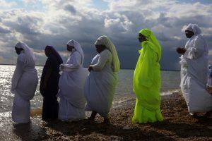 Female members of the Apostles Of Muchinjikwa Christian church prepare to enter into the sea during a mass Baptism (Jorodhani) on the beachfront on Southend-on-Sea, Britain, August 25, 2018. REUTERS/Simon Dawson