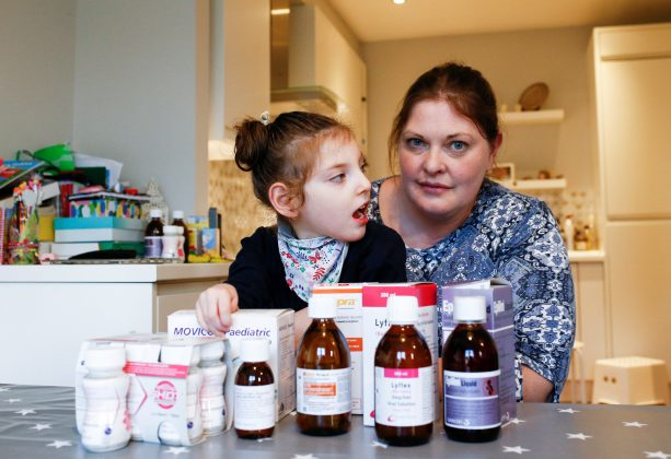 Jo Elgarf is seen with her daughter Nora and the child's prescription medicine at their home in London, Britain, January 30, 2019. REUTERS/Henry Nicholls