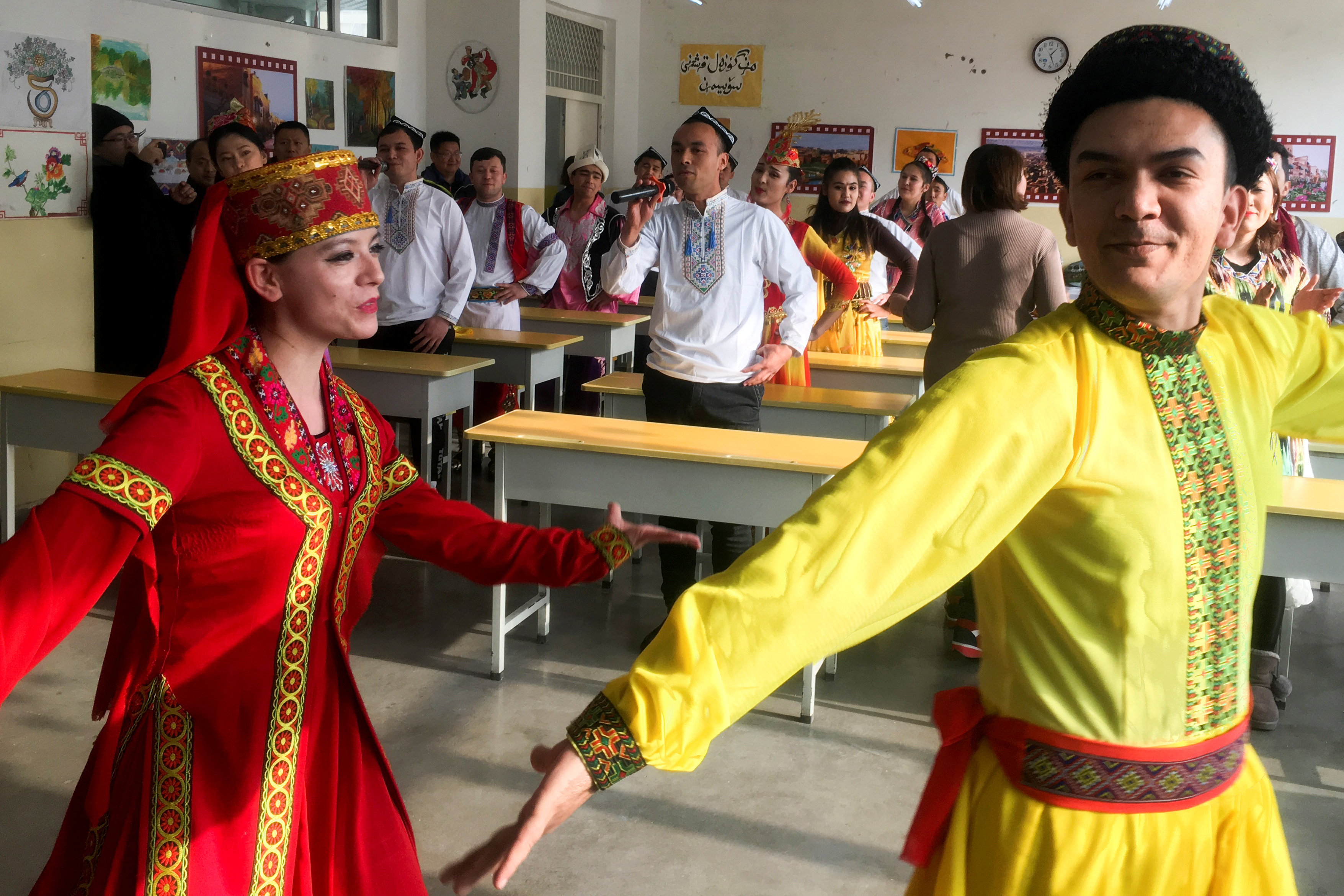FILE PHOTO: Residents at the Kashgar city vocational educational training centre dance for visiting reporters and officials in a classroom during a government organised visit in Kashgar, Xinjiang Uighur Autonomous Region, China, January 4, 2019. REUTERS/Ben Blanchard/File Photo