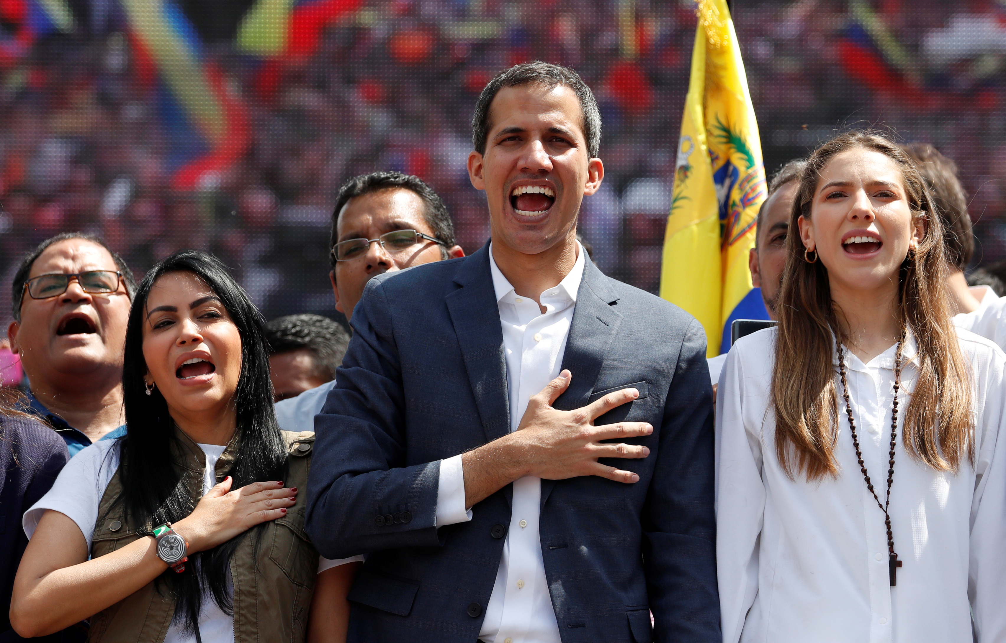 Venezuelan opposition leader and self-proclaimed interim president Juan Guaido and his wife Fabiana Rosales gesture during a rally against Venezuelan President Nicolas Maduro's government in Caracas, Venezuela February 2, 2019. REUTERS/Carlos Garcia Rawlins