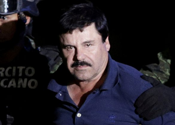 "FILE PHOTO: FILE PHOTO: Recaptured drug lord Joaquin ""El Chapo"" Guzman is escorted by soldiers at the hangar belonging to the office of the Attorney General in Mexico City, Mexico January 8, 2016. REUTERS/Henry Romero/File Photo"