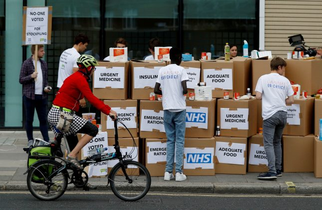 FILE PHOTO: Protesters demonstrate against the possible stockpiling of medicines and food in the event of a no-deal Brexit in London, Britain. Aug 22, 2018. REUTERS/Peter Nicholls/File Photo