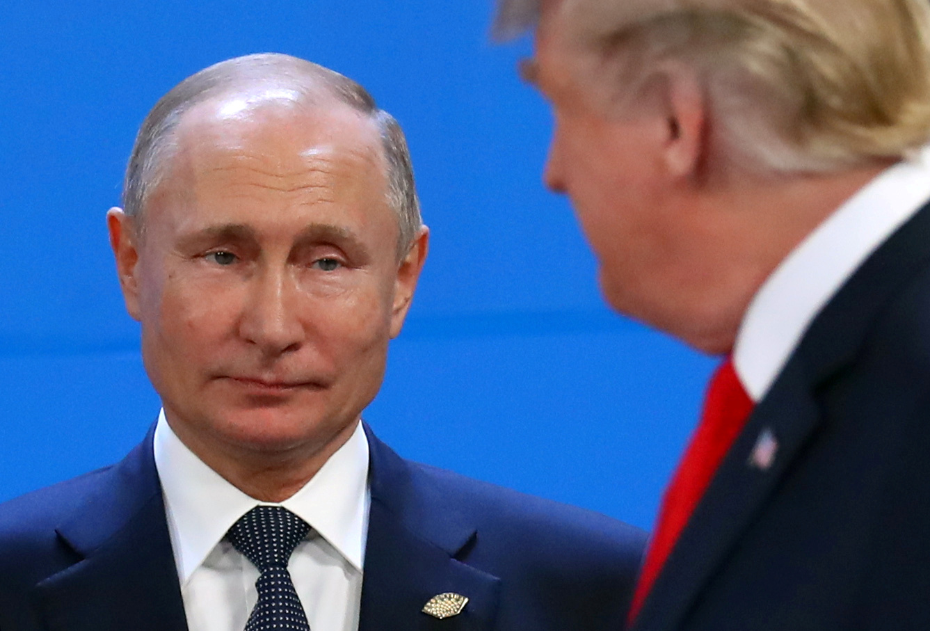 FILE PHOTO: Russia's President Vladimir Putin and U.S. President Donald Trump are seen during the G20 summit in Buenos Aires, Argentina November 30, 2018. REUTERS/Marcos Brindicci/File Pho