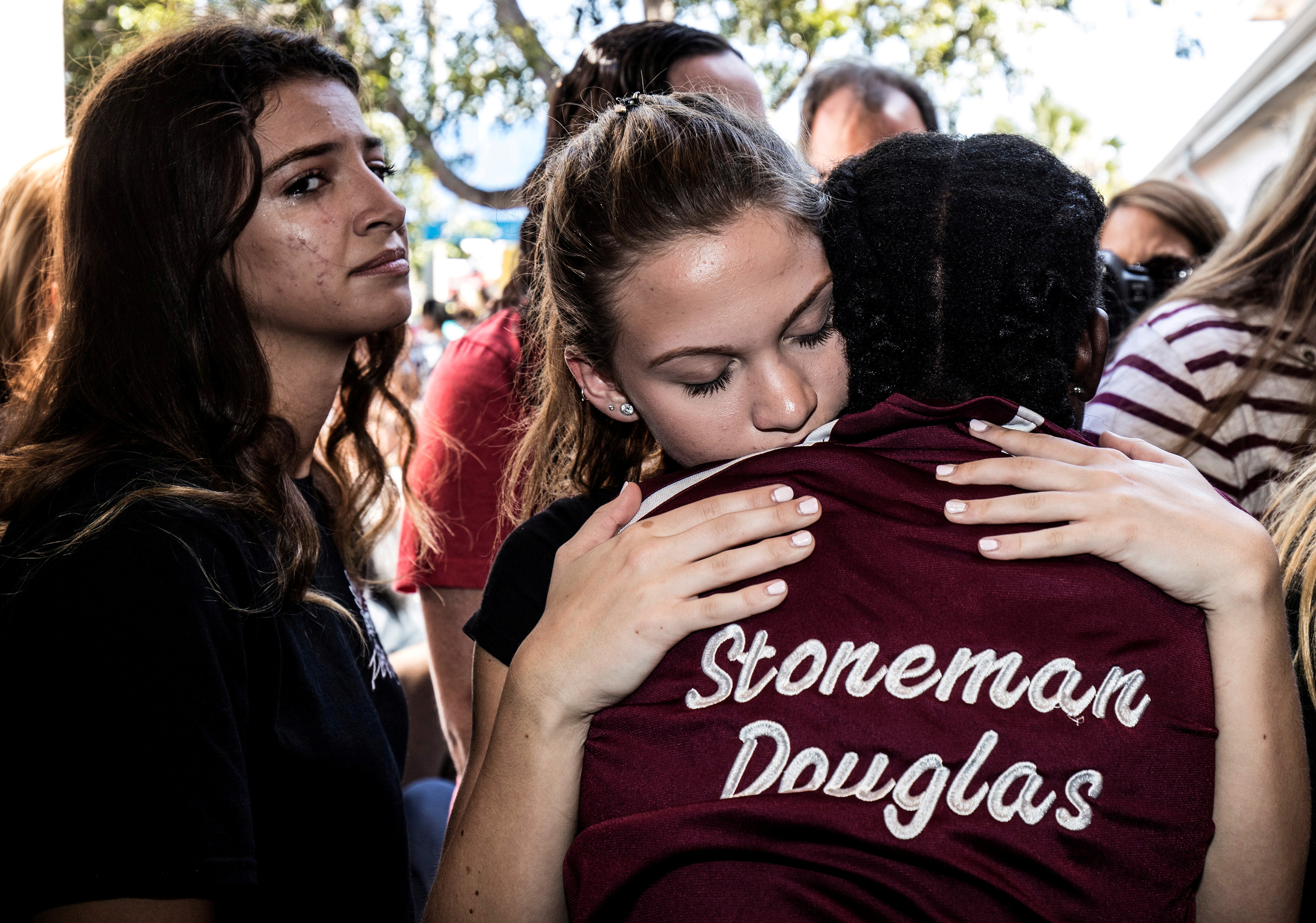 FILE PHOTO: Students from Marjory Stoneman Douglas High School attend a memorial following a school shooting incident in Parkland, Florida, U.S., February 15, 2018. REUTERS/Thom Baur/File Photo