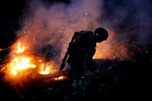 A soldier burns an illegal opium plantation near Pueblo Viejo in the Sierra Madre del Sur, in the southern state of Guerrero, Mexico, August 24, 2018. REUTERS/Carlos Jasso