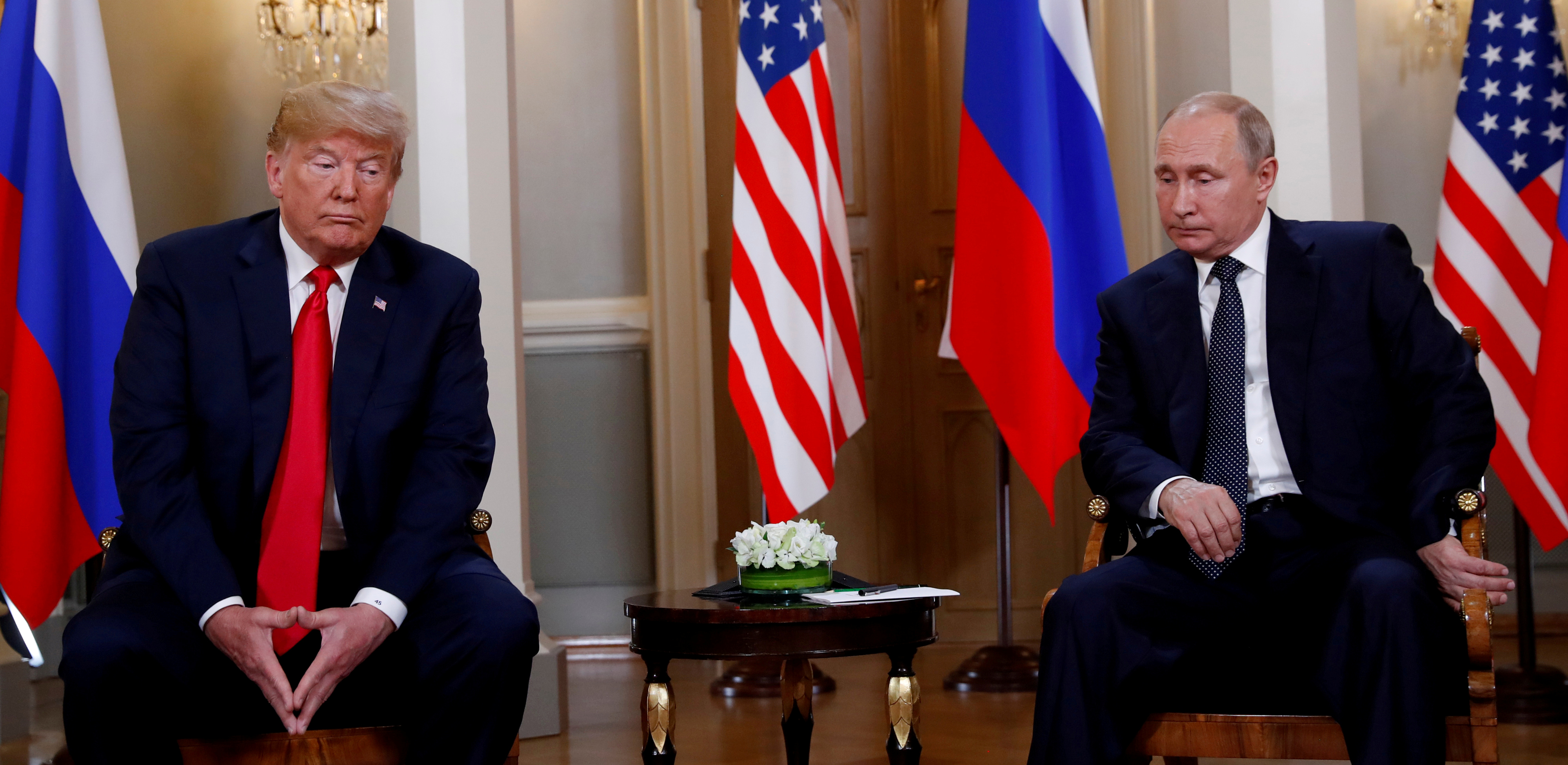 FILE PHOTO: U.S. President Donald Trump meets Russian President Vladimir Putin in Helsinki, Finland, July 16, 2018. REUTERS/Kevin Lamarque/File Photo