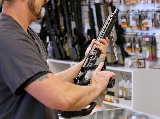 "FILE PHOTO: A prospective buyer examines an AR-15 at the ""Ready Gunner"" gun store In Provo, Utah, U.S. in Provo, Utah, U.S., June 21, 2016. REUTERS/George Frey/File Photo"