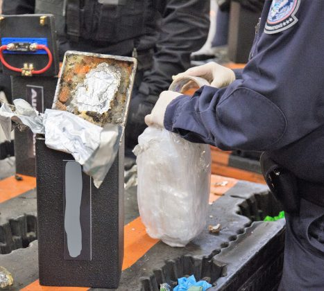 A U.S. Customs and Border Patrol officer extracts methamphetamine concealed in a loud speaker found in a shipment at the Los Angeles/Long Beach seaport bound for Australia, in this photo provided by U.S. Customs and Border Patrol, in Los Angeles, California, U.S., February 9, 2019. CBP/Handout via REUTERS
