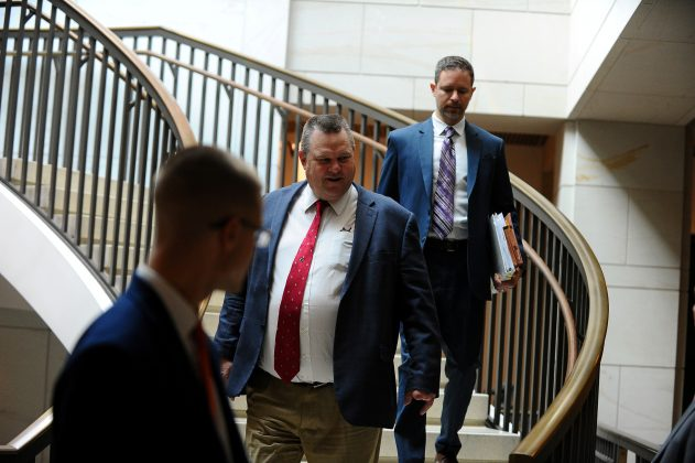 "Sen. Jon Tester (D-MT) arrives for a meeting with U.S. House-Senate conferees to receive a closed briefing from U.S. Border Patrol career professionals, who discuss ""the challenges they face protecting the U.S.-Mexico border"" at the U.S. Capitol in Washington, U.S., February 6, 2019. REUTERS/Mary F. Calvert"