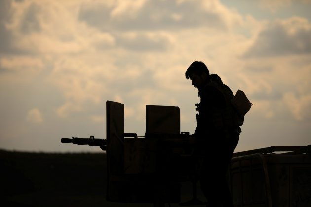 A member of Syrian Democratic Forces (SDF) stands on a pick up truck mounted with a weapon near Baghouz, Deir Al Zor province, Syria February 11, 2019. REUTERS/ Rodi Said