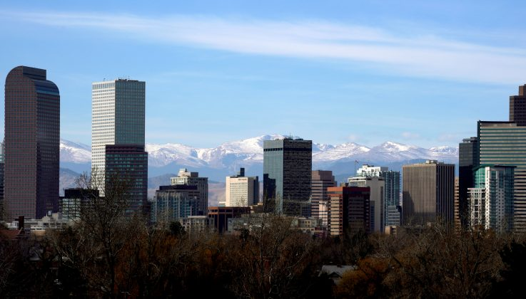 FILE PHOTO: The Continental Divide is seen in the background behind the downtown city skyline in Denver, Colorado, U.S., November 16, 2017. REUTERS/Rick Wilking/File Photo