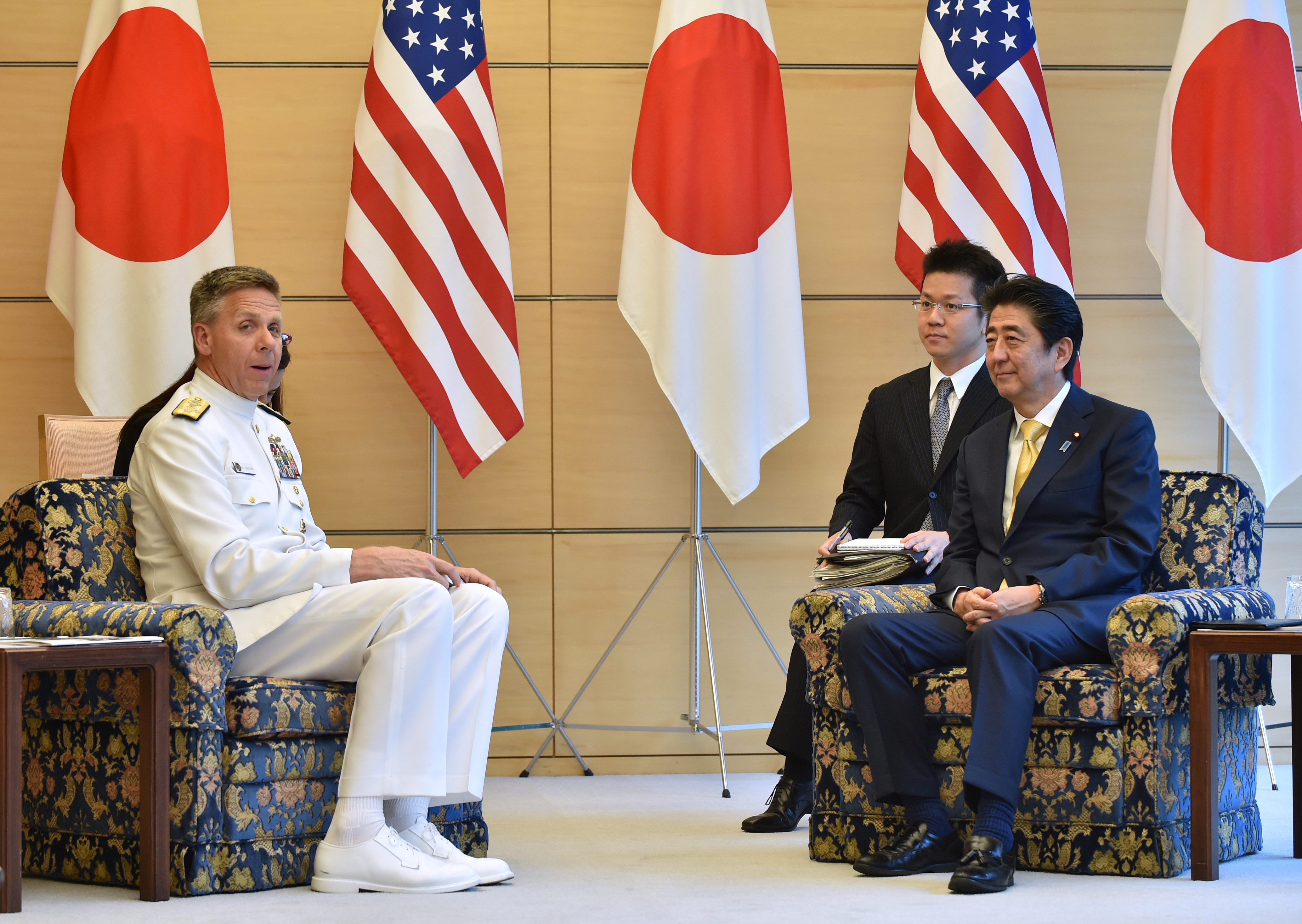 FILE PHOTO: Admiral Philip S. Davidson (L), Commander of U.S. Indo-Pacific Command, meets with Japan's Prime Minister Shinzo Abe at Abe's office in Tokyo, Japan June 21, 2018. Kazuhiro Nogi/Pool via Reuters